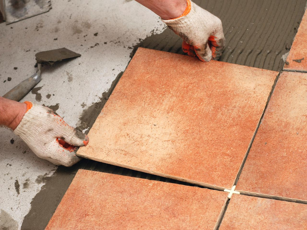 Istock 6844398man laying tile floorings4x3gndhgtvcom istock 6844398man laying tile floorings4x3gndhgtvcom1280960 dailygadgetfo Choice Image